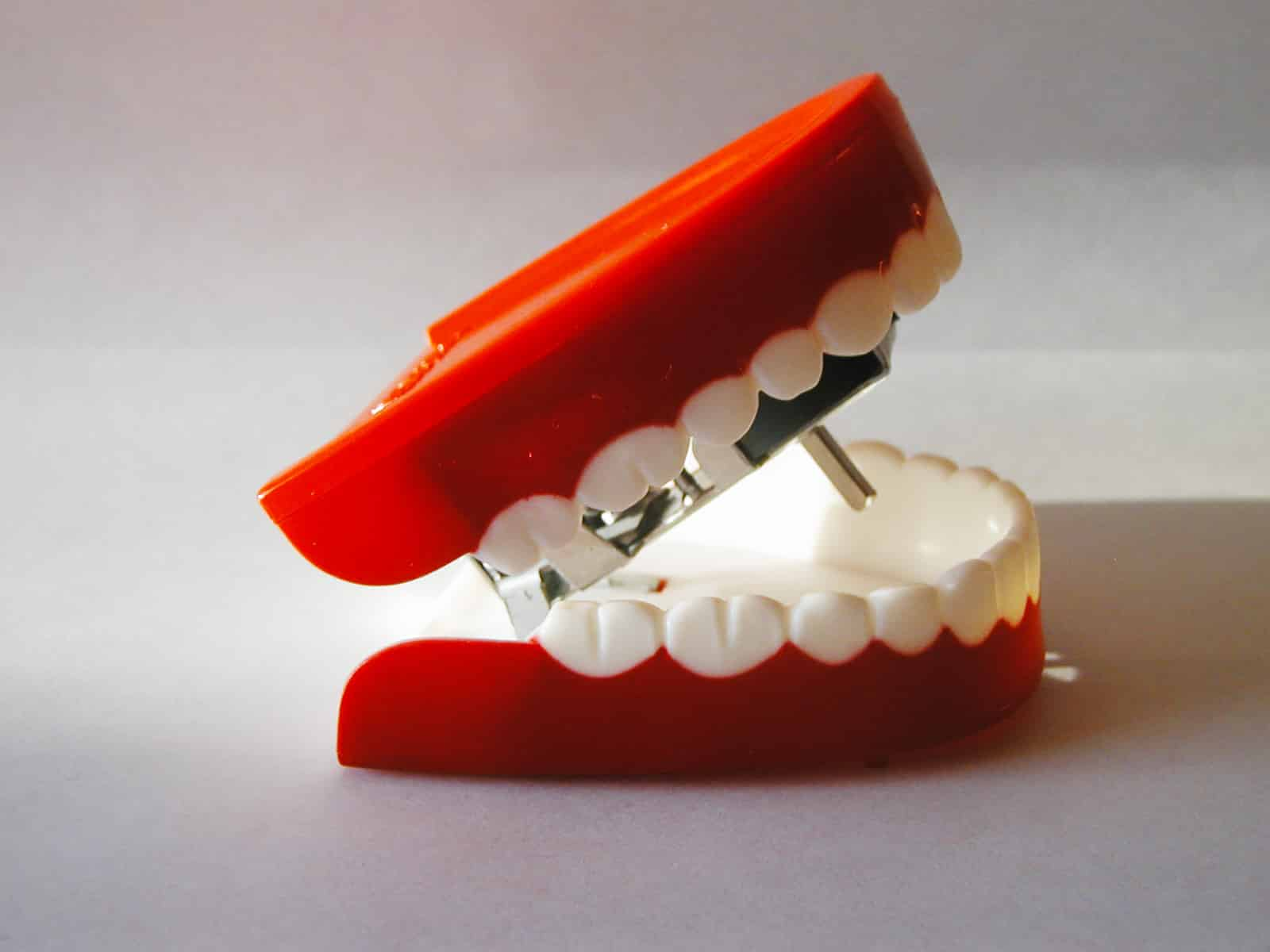 The Difference Between Dentures & Implants